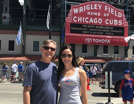 Dr. Fana and his wife at Wrigley Field